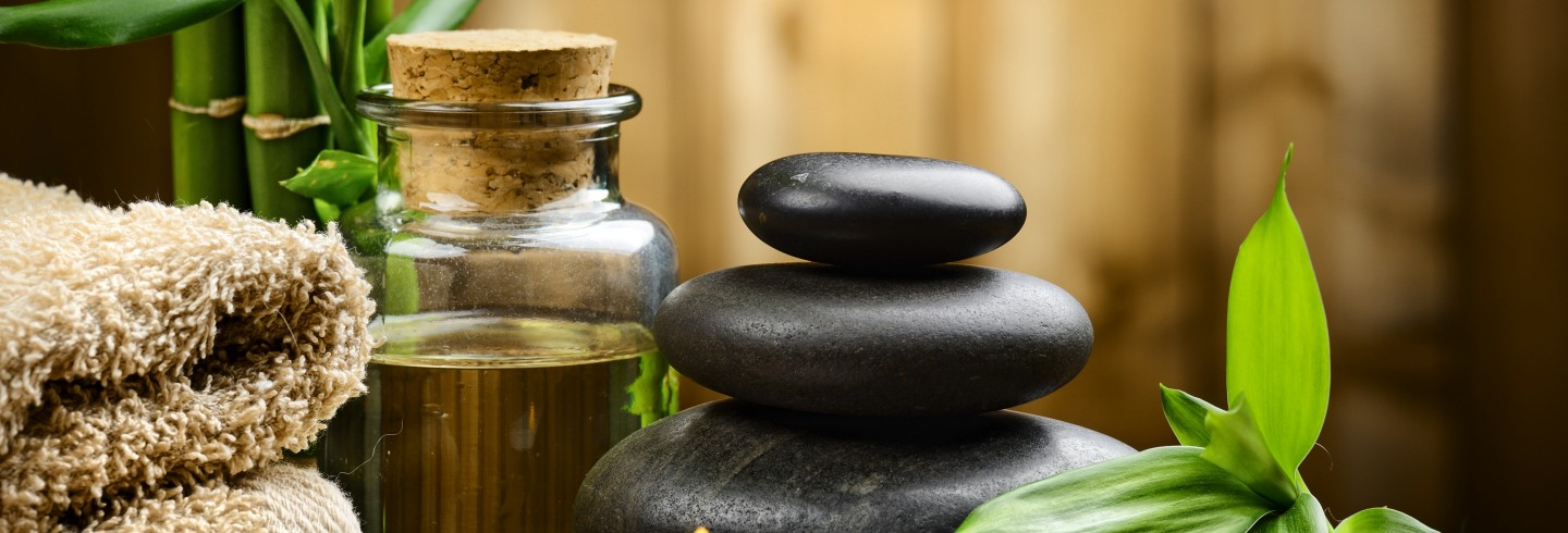 massage oil and hot rocks